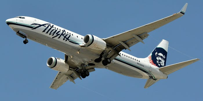 A gay nightclub owner says he and his partner were forced to separate on an Alaskan Airlines flight so a straight couple could sit together.
