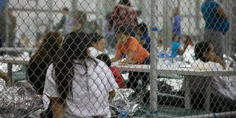 Immigrants at a U.S. Customs and Border Protection intake facility.