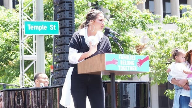 Chrissy Teigen Keep Families Together march