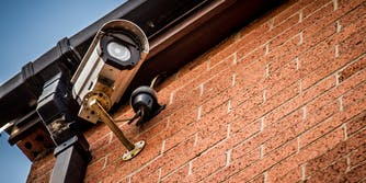 Security camera attached to building