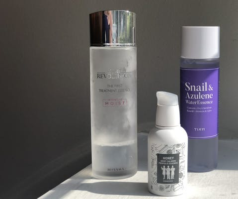 Three essence bottles standing on a shelf