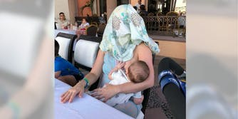 A mom was asked to 'cover up' while breastfeeding her baby—so she covered her own head.