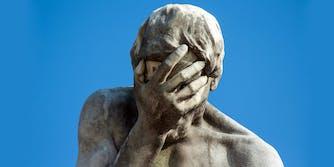cain tuileries facepalm statue
