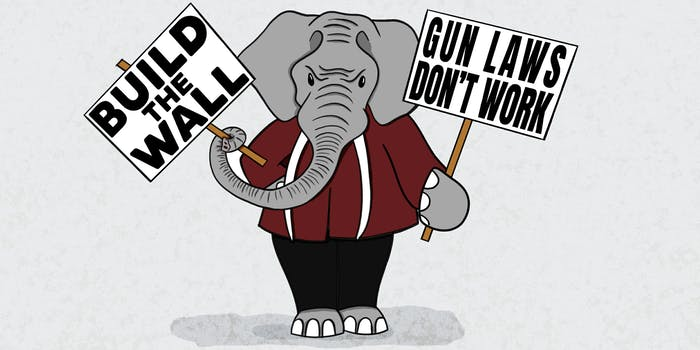 """gop elephant holding protest signs that read """"build the wall"""" and """"gun laws don't work"""""""