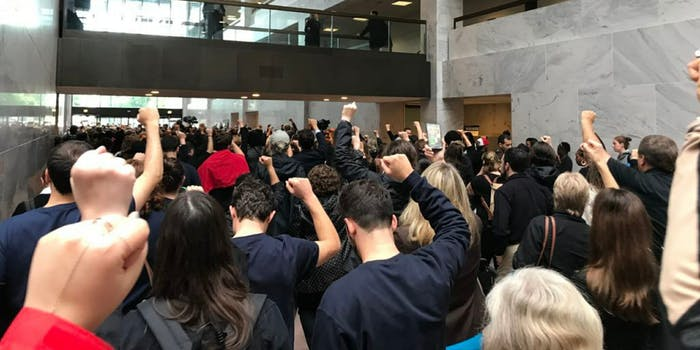 People walking of the Hart Senate building out for the #BelieveSurvivors protest