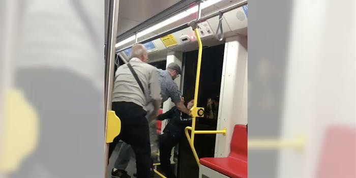 Footage from a San Francisco Muni showed two men trying to push another young man from the train.