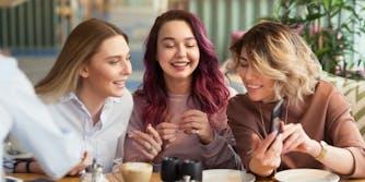 women talking in coffee shop