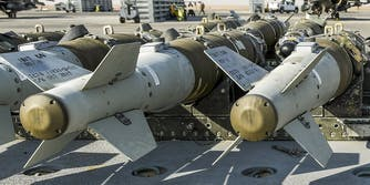 Pentagon weapons loaded onto an F-16 Fighting Falcon aircraft