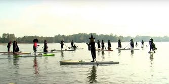 Witches paddleboarding in Oregon.