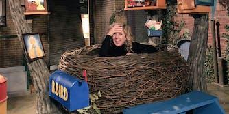 woman in big birds nest