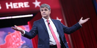 Fox News pundit Sean Hannity appeared on stage with President Donald Trump at a rally on Monday despite saying he wouldn't.