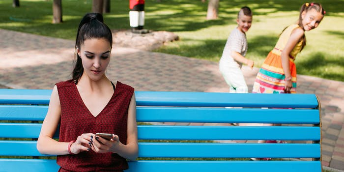 children leaving babysitter looking at phone
