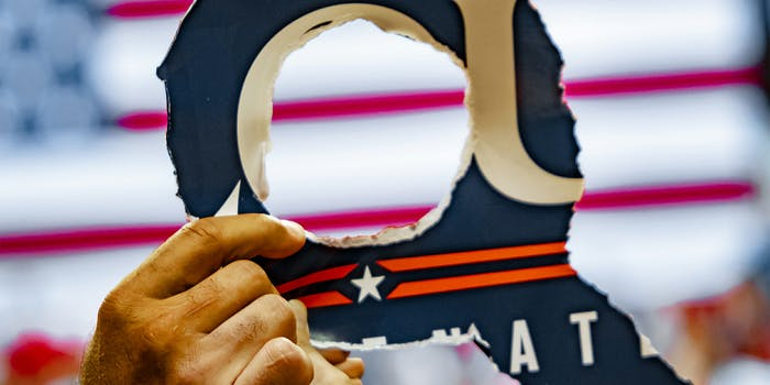 trump rally Q sign
