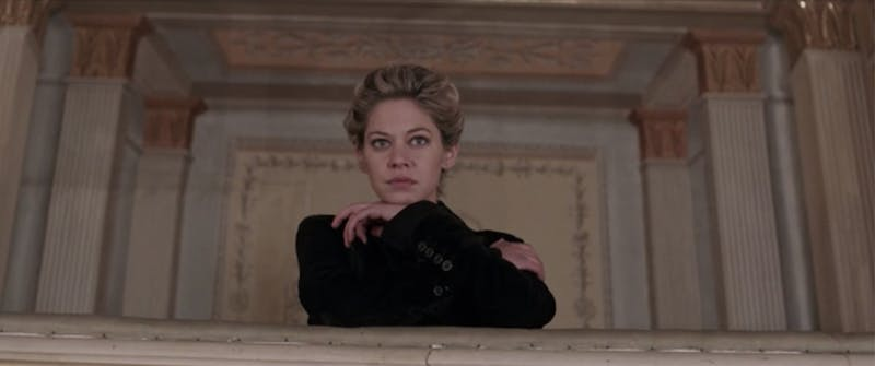 A woman leans on her arms in a scene from Compulsion