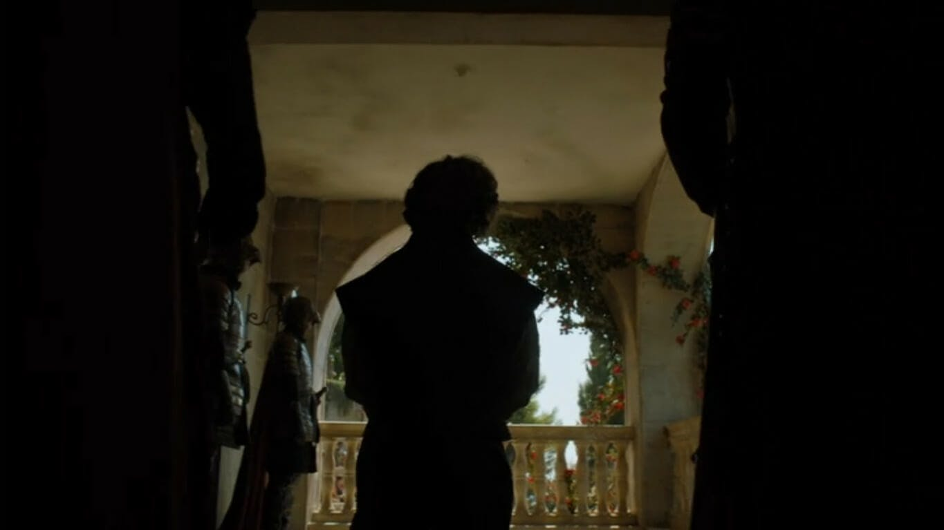 Image showing Tyrion Lannister's silhouette, flanked by guards