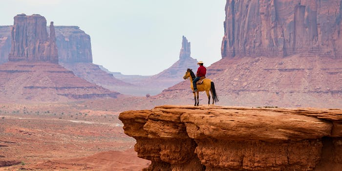 cowboy looking over mountain range