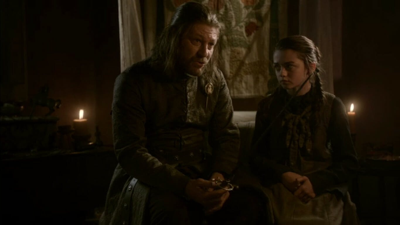 Image showing Eddard Stark talking to his daughter, who sits beside him. If you wanted Ned to live on, this Game of Thrones fanfiction is for you