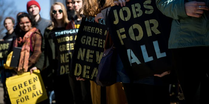 people holding green new deal signs