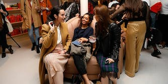 women sitting on chair and talking in Wing co-working space