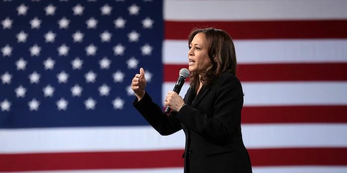 Kamala Harris standing against an American flag
