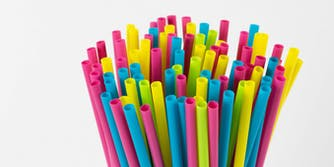 A stack of colorful plastic straws