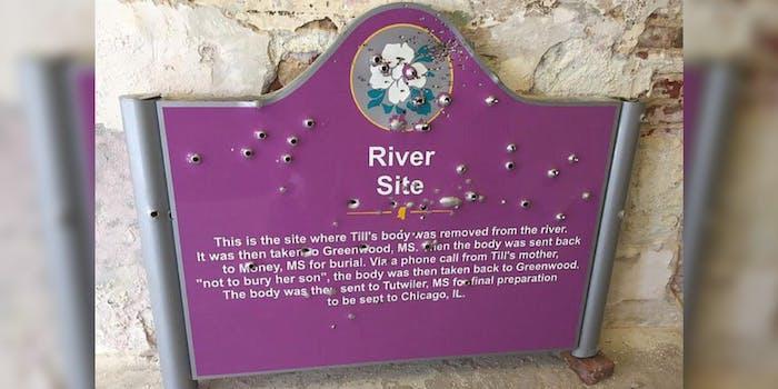 A memorial for Emmett Till shows bullet holes
