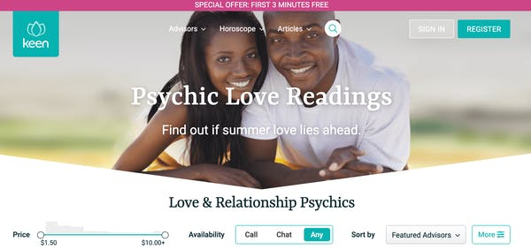 """A couple snuggles close and smiles at the camera behind a """"psychic love readings"""" banner"""