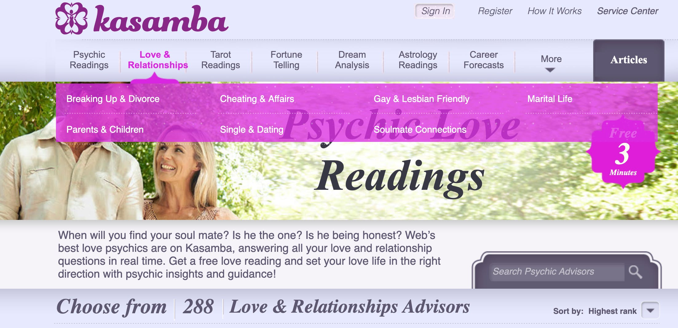 A couple gazes lovingly at each other as they walk together behind a banner for psychic love readings