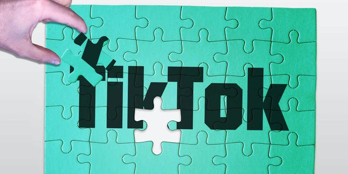 A hand shown completing a jigsaw puzzle with the text TikTok