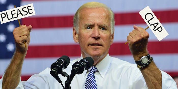 """joe biden with """"please clap"""" signs in his hands"""