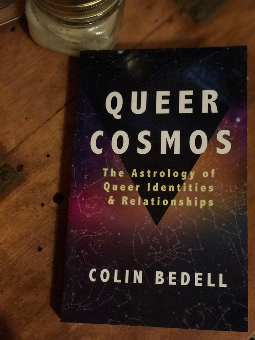 """Cover of the book """"Queer Cosmos: The Astrology of Queer Identities and Relationships"""" by Colin Bedell."""