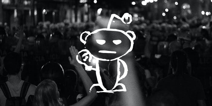 reddit snoo with raised fist over protest background