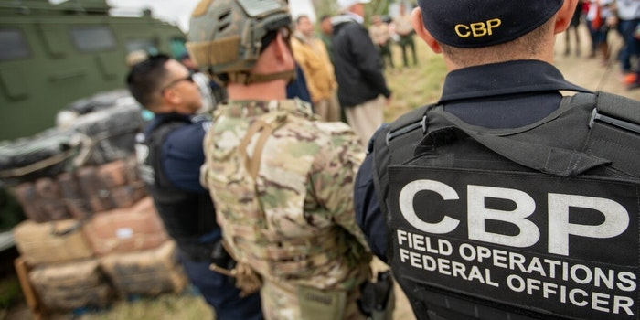 Customs and Border Protection officials wearing a hat and a jacket with the logo