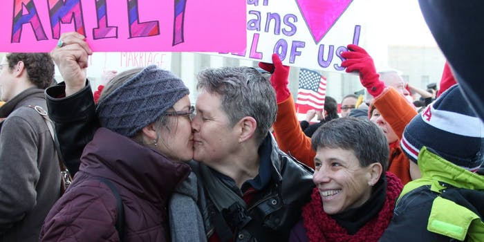 Two women are seen kissing at a Marriage Equality rally at the US Supreme Court in 2013