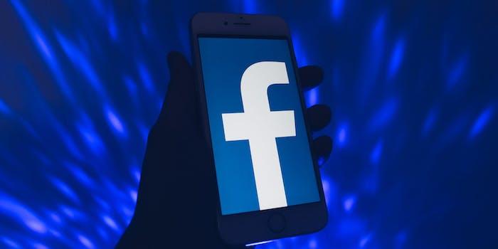 Facebook logo seen on a phone screen