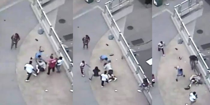 Screengrabs show the mob beating, kicking and running a bicycle over a victim