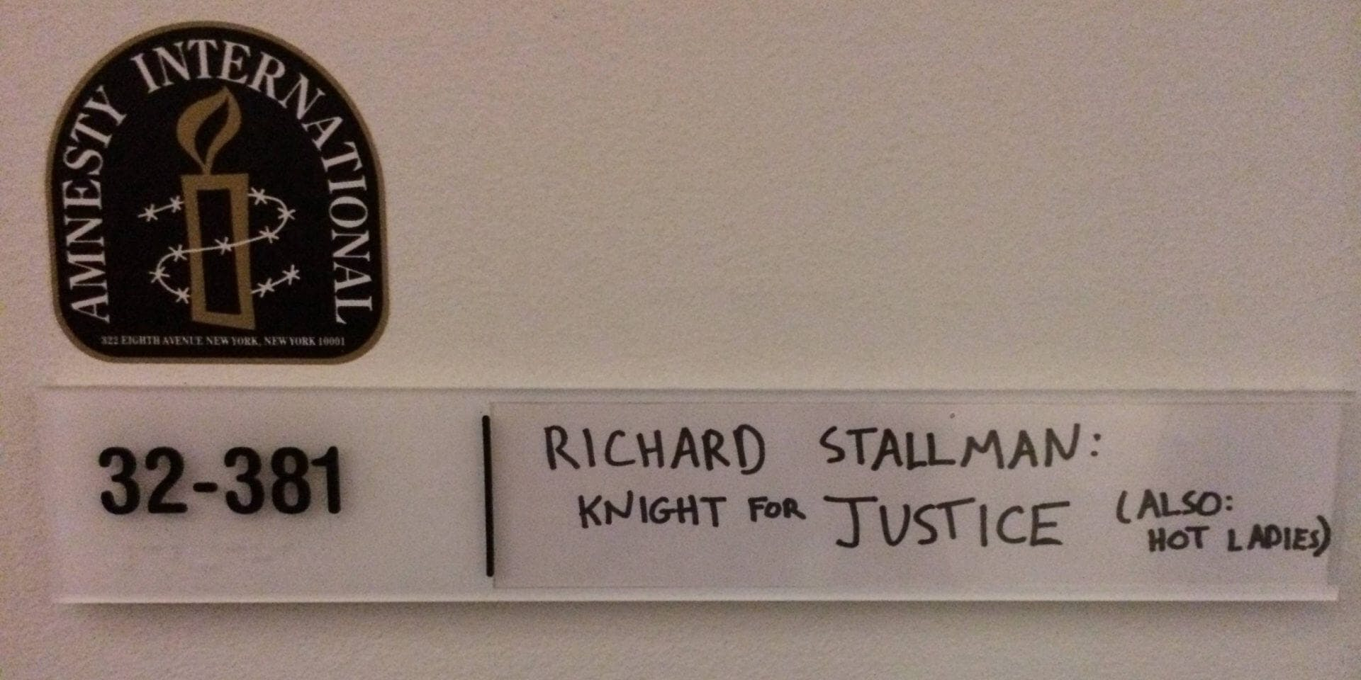 A door sign for Richard Stallman reads 'Knight for justice (also: hot ladies)