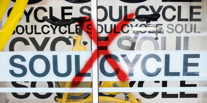 soulcycle store window spray painted with a red X