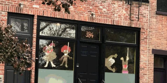 Window decorations show caricatures of children made out of brown paper seen in nooses
