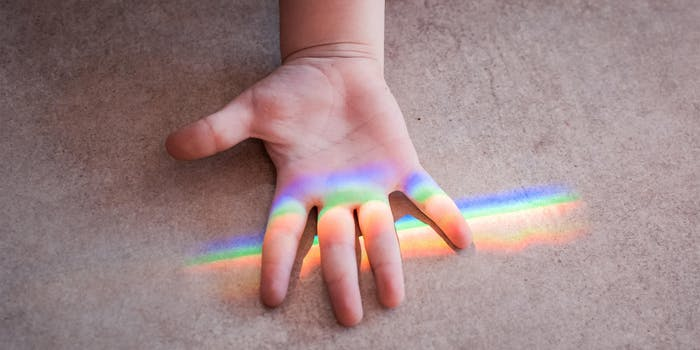 child's hand under rainbow / protect james younger