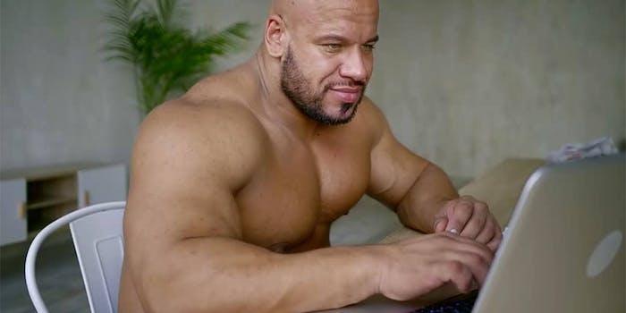 buff guy typing on laptop