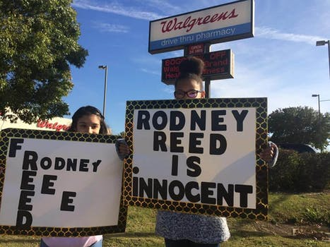 Protesters hold placards claiming Rodney Reed's innocence