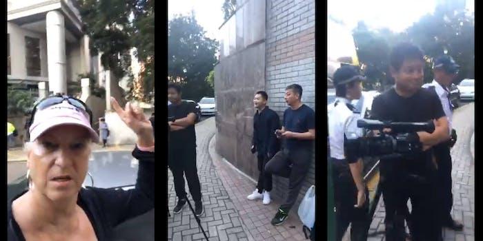 men filming hong kong election voters