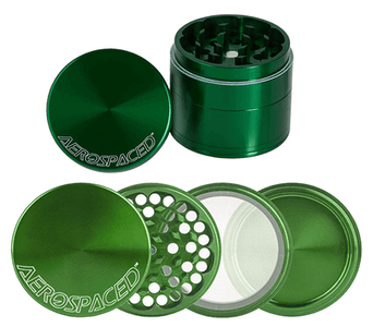 An Aerospaced three-chamber grinder shown disassembled to show how worthwhile and easy it is to use this weed accessory.