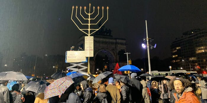 Photos showed members from the community braving the rain to sing and dance around the Menorah