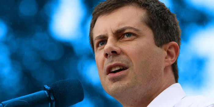 pete buttigieg at mic with blue background