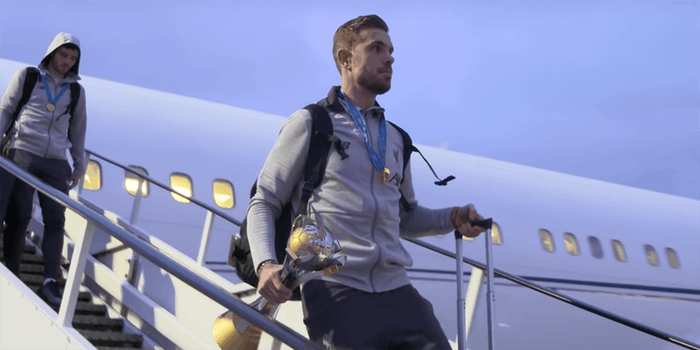Jordan Henderson leaves plane with FIFA Club World Cup trophy