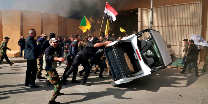 Protesters damage property inside the U.S. embassy compound, in Baghdad, Iraq