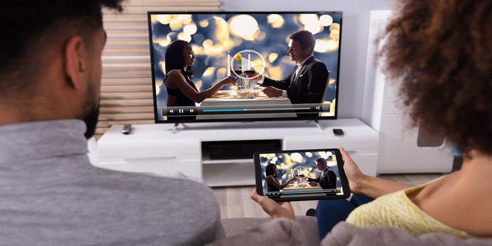couple pairing a tablet to their television