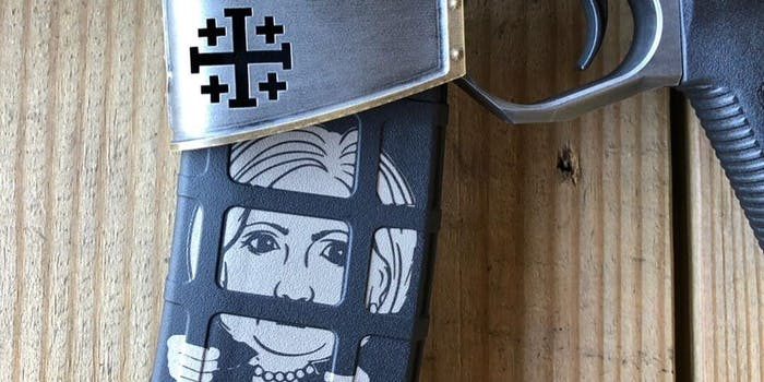 The rifle shows Clinton behind bars and a Jerusalem Cross etched